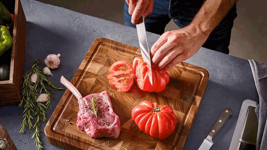 Kitchen Knife cutting a tomato